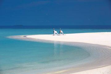 Anantara Kihavah Villas Yoga on the beach
